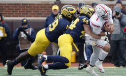 Nov 30, 2019; Ann Arbor, MI, USA; Ohio State Buckeyes quarterback Justin Fields (1) is tackled by Michigan Wolverines linebacker Cameron McGrone (44) and defensive lineman Kwity Paye (19) in the first half at Michigan Stadium. Mandatory Credit: Rick Osentoski-USA TODAY Sports