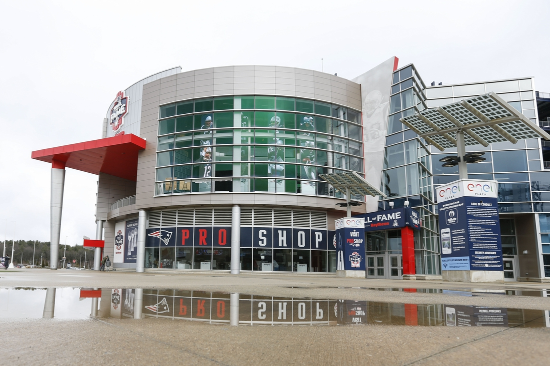 Mar 17, 2020; Foxborough, Massachusetts, USA; A reflection  of the New England Patriot Hall of Fame Store at Gillette Stadium.  An image of former quarterback Tom Brady is visible through the window. Mandatory Credit: Greg M. Cooper-USA TODAY Sports