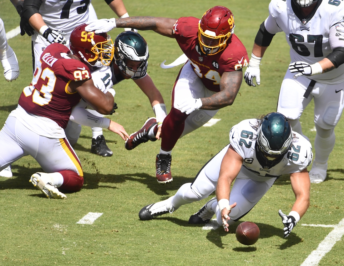 Sep 13, 2020; Landover, Maryland, USA; Philadelphia Eagles cornerback Avonte Maddox (29) recovers a fumble against the Washington Football Team during the first half quarter at FedExField. Mandatory Credit: Brad Mills-USA TODAY Sports