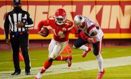 Oct 5, 2020; Kansas City, Missouri, USA; Kansas City Chiefs wide receiver Sammy Watkins (14) is tackled by New England Patriots defensive back J.C. Jackson (27) during the third quarter of a NFL game at Arrowhead Stadium. Mandatory Credit: Jay Biggerstaff-USA TODAY Sports