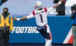 Nov 1, 2020; Orchard Park, New York, USA; New England Patriots quarterback Cam Newton (1) scores a touchdown  against the Buffalo Bills in the fourth quarter at Bills Stadium. Mandatory Credit: Mark Konezny-USA TODAY Sports