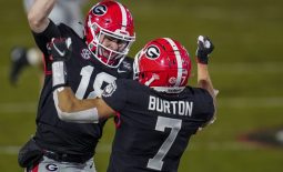 Nov 21, 2020; Athens, Georgia, USA; Georgia Bulldogs wide receiver Jermaine Burton (7) reacts with quarterback JT Daniels (18) after connecting on a long touchdown pass against the Mississippi State Bulldogs during the second half at Sanford Stadium. Mandatory Credit: Dale Zanine-USA TODAY Sports