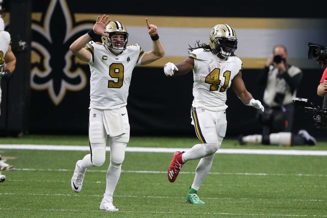 Dec 25, 2020; New Orleans, Louisiana, USA; New Orleans Saints quarterback Drew Brees (9) gestures after running back Alvin Kamara (41) scored his sixth touchdown of the game in the fourth quarter against the Minnesota Vikings at the Mercedes-Benz Superdome. Mandatory Credit: Chuck Cook-USA TODAY Sports