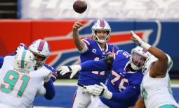 Jan 3, 2021; Orchard Park, New York, USA; Buffalo Bills quarterback Josh Allen (17) throws a pass against the Miami Dolphins during the second quarter at Bills Stadium. Mandatory Credit: Rich Barnes-USA TODAY Sports