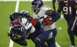 Jan 3, 2021; Houston, Texas, USA; Tennessee Titans running back Derrick Henry (22) runs with the ball during the fourth quarter against the Houston Texans at NRG Stadium. Mandatory Credit: Troy Taormina-USA TODAY Sports