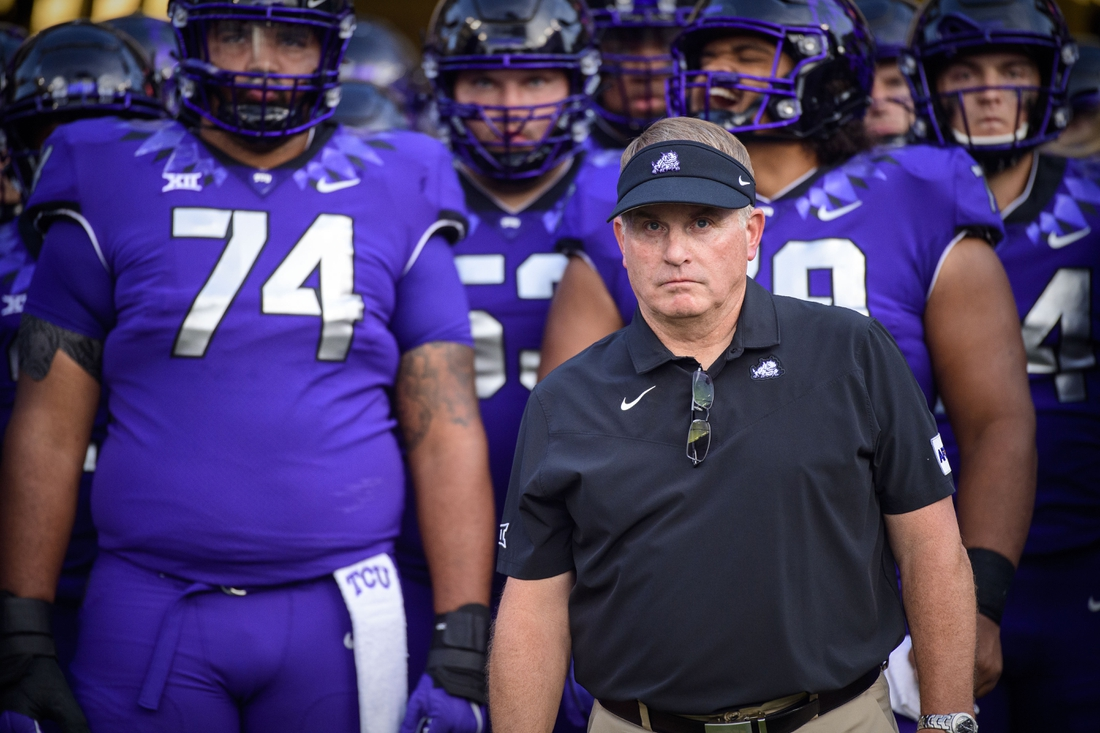 Sep 4, 2021; Fort Worth, Texas, USA; TCU Horned Frogs head coach Gary Patterson and his team before the game between the TCU Horned Frogs and the Duquesne Dukes at Amon G. Carter Stadium. Mandatory Credit: Jerome Miron-USA TODAY Sports