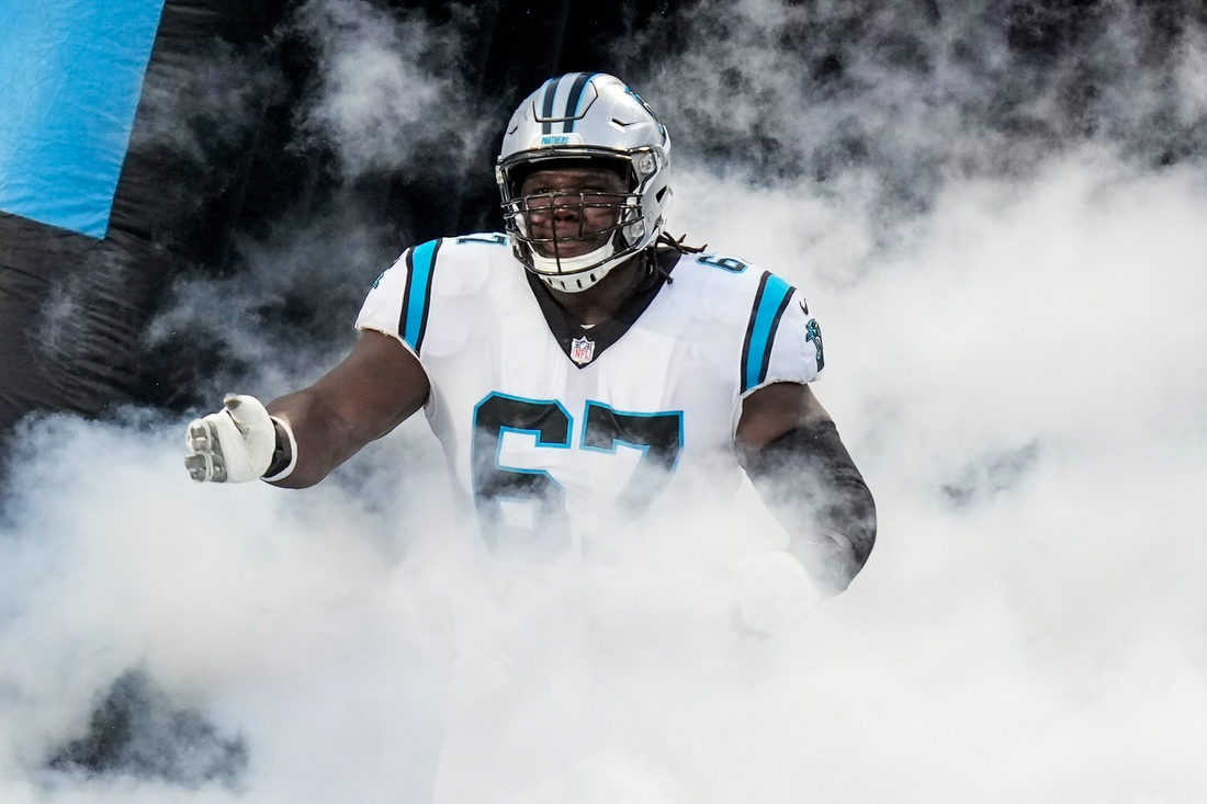 Aug 27, 2021; Charlotte, North Carolina, USA; Carolina Panthers offensive guard John Miller (67) runs onto the field during the first quarter against the Pittsburgh Steelers at Bank of America Stadium. Mandatory Credit: Jim Dedmon-USA TODAY Sports