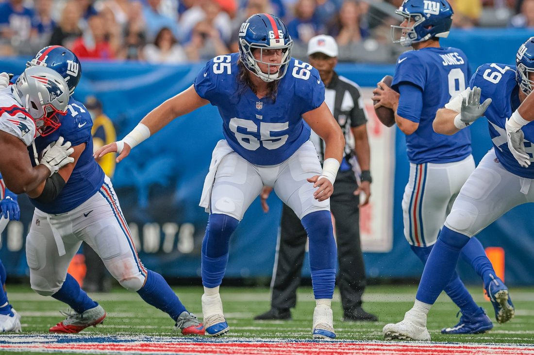 Aug 29, 2021; East Rutherford, New Jersey, USA; New York Giants center Nick Gates (65) blocks against the New England Patriots during the first half at MetLife Stadium. Mandatory Credit: Vincent Carchietta-USA TODAY Sports