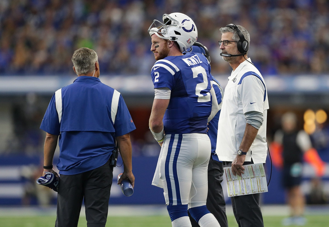 Indianapolis Colts head coach Frank Reich (right) talks with quarterback Carson Wentz (2) on Sunday, Sept. 12, 2021, at Lucas Oil Stadium and Indianapolis. The Seahawks defeated the Colts, 28-16.  Indianapolis Colts And Seattle Seahawks On Nfl Week 1 At Lucas Oil Stadium Sunday Sept 12 2021