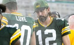 Sep 12, 2021; Jacksonville, Florida, USA; Green Bay Packers quarterback Aaron Rodgers (12) speaks with  quarterback Jordan Love (10)  during the game against the New Orleans Saints at TIAA Bank Field. Mandatory Credit: Tommy Gilligan-USA TODAY Sports