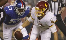 Sep 16, 2021; Landover, Maryland, USA; Washington Football Team quarterback Taylor Heinicke (4) is sacked by New York Giants linebacker Azeez Ojulari (51) in the first quarter at FedExField. Mandatory Credit: Geoff Burke-USA TODAY Sports