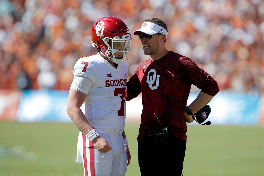 Oklahoma coach Lincoln Riley talks with Oklahoma's Spencer Rattler (7) before a two point-conversion attempt during the Red River Showdown college football game between the University of Oklahoma Sooners (OU) and the University of Texas (UT) Longhorns at the Cotton Bowl in Dallas, Saturday, Oct. 9, 2021.  Oklahoma won 55-48.  Ou Vs Texas