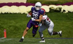 Oct 16, 2021; Evanston, Illinois, USA; Northwestern Wildcats running back Evan Hull (26) runs with the football in the first half against Rutgers Scarlet Knights linebacker Mohamed Toure (58) at Ryan Field. Mandatory Credit: Quinn Harris-USA TODAY Sports
